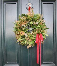 Natural christmas door wreath with velvet flourish
