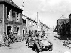 Carentan. France. June 10-14, 1944.   Paratroopers of the 101st Airborne Division, with a Kübelwage of the Luftwaffe.