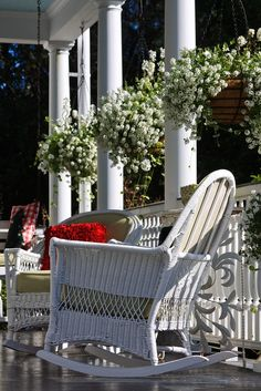 Front Porch rocker and wicker furniture.  Red pillows add that touch of flare that makes relaxing an every day event here.