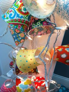Camper Lights:  String lights, plastic cups, mod podge, fabric.  Would be so beautiful outside in the garden.