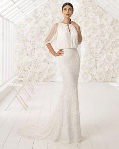 Si quieres ser una novia de cuento, no puedes pasar por alto este fantástico vestido estilo boho con un cuidado encaje y una fina pedrería. Su cuerpo ablusonado le aporta un aire muy romántico.
