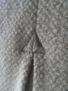 Embroidered Triangle - sewing; textiles; stitching; geometric embroidery; couture fashion design detail
