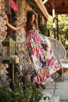 This floral dress makes we want to vacation to wherever that rock walled home is!