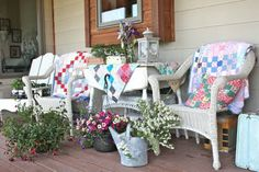 Quilts and wicker makes for a cozy front porch!