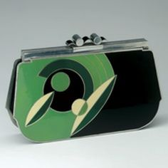 1930's Art Deco bag - Enamel and chrome frame is typically Art Deco with its geometric shapes and colors trenches - Museum of Bags and Purses, Amsterdam