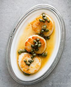 Large sea scallops, seared and topped with browned butter sauce with capers and lemon zest. On SimplyRecipes.com