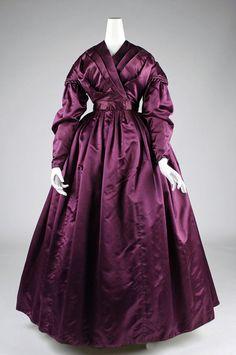 Plum silk dress with wrap bodice. c. 1840.