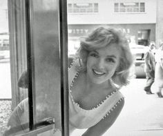 """Monroe shopping in New York City - 1957. Photographer Sam Shaw.   """"LIFE magazine called me up and said they would like to have Marilyn Monroe come over to the store to shop, and they wanted to take pictures. Later that day, I called down to the store and my partner says to me, 'The store is closed.' I said, 'What do you mean it's closed?' He says, 'Marilyn Monroe is here, they spotted her, they have cops in front of the store and everything'"""" – Sam Anfang, owner of Gentree."""