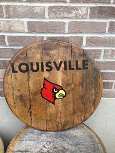 U of L cardinal bourbon whiskey barrel head on Etsy, $60.00