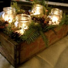 Votive candles in mason jars in Pepsi crate