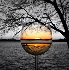 Sunset thru her wine glass.