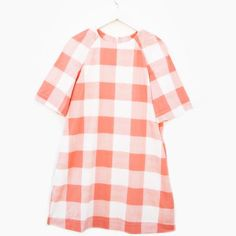 Our coral gingham 3/4 sleeve dress is perfect for fall & winter. Pair with booties and tassel earrings.