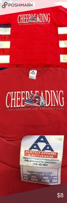"""Red """"cheerleading, an American tradition"""" t-shirt This is a size medium patriotic red T-shirt…cheerleading, an American tradition is perfect for any cheerleader or cheerleading fan! There are just a couple little spots which are very light and hardly noticeable in the pictures. I hope you will love the shirt! Thank you for shopping with me today! Have a great weekend! Tops Tees - Short Sleeve"""