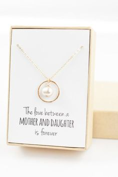 How about a sweet necklace showing concrete bond between mother and daughter