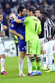Juventus goalkeeper Gianluigi Buffon, left, greets Real Madrid goalkeeper Iker Casillas at the end of the Champions League, Group B, soccer ...