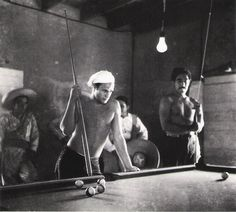 """Marlon Brando, Anthony Quinn in background. Taking a break from the shooting of """"Viva Zapata"""". 1952."""