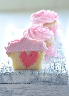 These Valentine's Day heart cupcakes are simple adorable! Cut these cupcakes from any side and end up with a heart on the inside Heart Cupcakes, Yummy Cupcakes, Pink Cupcakes, Vanilla Cupcakes, Filled Cupcakes, Sweet Cupcakes, Strawberry Cupcakes, Baking Cupcakes, Cupcake Recipes