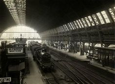 1930. A view of the Westzijde of the Centraal Station in Amsterdam. The Centraal Station is a major national railway hub used by appr. 300,000 passengers a day. The railway station was designed by Pierre Cuypers, who is also known for his design of the Rijksmuseum. It features a Gothic/Renaissance Revival style and a cast iron platform roof spanning of appr. 40 meters. Centraal Station opened in 1889. Photo #amsterdam #1930 #CentraalStation