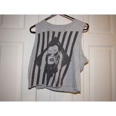 Gray Crop Top! Gray with black designs; fits more like a large than an extra large.  Tops Crop Tops
