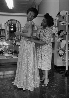 Eartha Kitt photographed by Gordon Parks as she was being fitted for a dress by a woman who I am 99.9% sure is none other than the pioneering fashion designer Zelda Wynn Valdes in 1952.