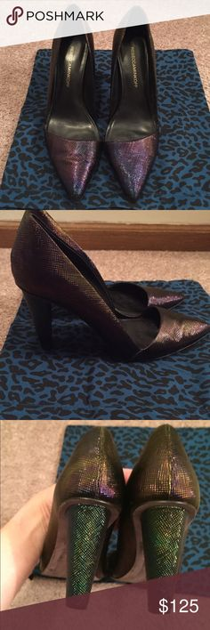 """Rebecca Minkoff Abel D'Orsay Oil Slick Pumps Rebecca Minkoff Abel Pumps. D'Orsay style heels. Color is oil slick - iridescent black which changes color in light. Women's size 8. Only worn a few times. Comes with dust bag but NO BOX. In great condition! Kept in dust bag. Embossed Metallic leather with a longer toe and covered geometric heel. Cut-out at inner vamp. Leather insole and sole. Heel height: 3.5"""". NO TRADES. All offers please use button. Rebecca Minkoff Shoes Heels"""