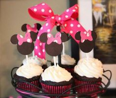 minnie-mouse-cake-toppers, with one large Minnie Mouse character (pink, black, yellow dress). Happy 2nd Birthday Evie in connected writing across cake.