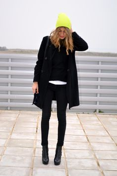 Neutral all black outfit with neon beanie