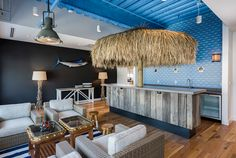 This nautical-based clothier incorporates a lively design in their headquarters, using our reclaimed painted Barn Wood as a bar wrap. Photos by kpn Photo Prefabricated Cabins, Stamford, Space Gallery, Home Trends, Cabin Homes, Office Interiors, Vineyard Vines, Barn Wood, Outdoor Decor