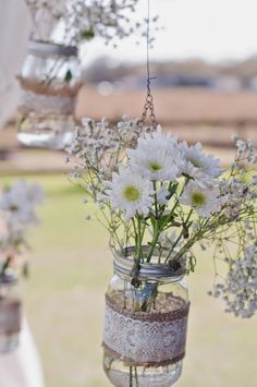 Mason jars with lace, burlap and simple flowers!  Love it!