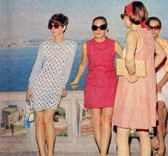 Audrey with friends wearing sheath dresses (hers has a sweet Peter Pan collar, long sleeves, a tiny pattern and body hugging fit) in Capri (Italy), June 1969.