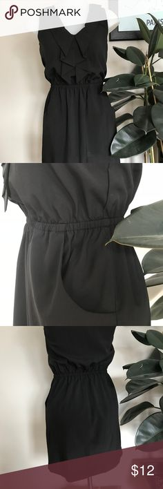 """Casual Little Black Dress Your go to closet item, this casually styled little black dress is the perfect """"throw on"""" for any occasion. Ruffle detail in the front with side pockets. 100% polyester, easy wash, good condition. Dresses Mini"""