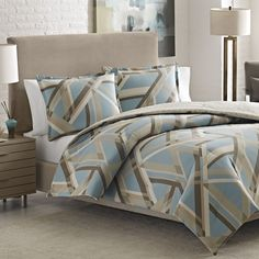 Add a beautiful, stylish touch to your guest or master bedroom with this Adrienne Vittidini Torre Duvet Cover Set featuring a comfortable cotton construction. This duvet cover set features a geometric pattern that will complement almost any decor.