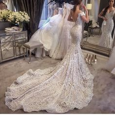 This sexy lace wedding gown can be recreated for you with any design changes and in any size.  Backless #weddingdresses can be customized in any way.  We also provide #replicas of designer dresses for brides on a budget who can not afford the original.  Email us your vision for pricing.  DariusCordell.com