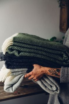 Cosy natural layers and blankets for the home.
