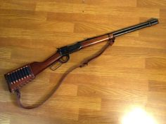 Winchester lever action rifle with wrap.