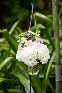 Pink and white wedding ceremony aisle markers - roses and hydrangeas in hanging jars along the aisle{Elizabeth Star Photography}