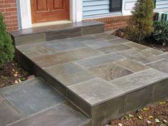 Porch in regular Pennsylvania flagstone by Concrete Master Solutions, LLC