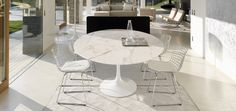 Love an oval table and the chairs are pretty sweet too - Knoll Saarinen Dining Table by Eero Saarinen