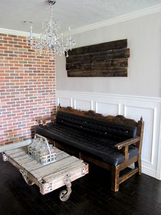 An exposed brick wall and a Miners Cart turned in to a coffee table, make a perfect little sitting space