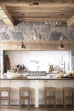 Modernish island in rustic kitchen.