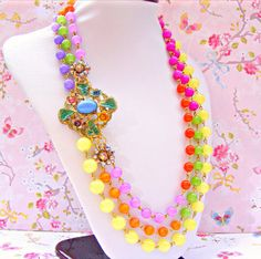 Hey, I found this really awesome Etsy listing at https://www.etsy.com/listing/151554024/colorful-retro-necklace-kitsch-1920s