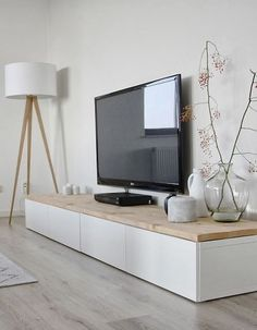 Quite like this. White and wood looks nice and I like the Tv low-ish on the wall like that.