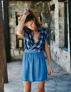 madewell courier shirt worn with the faded indigo skirt.