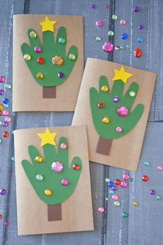 15 fun christmas crafts for kids handprint christmas tree cards. Handprint Christmas Tree, Christmas Tree Cards, Funny Christmas, Easy Kids Christmas Crafts, Christmas Decorations For Kids, Tree Handprint, Christmas Activities For Kids, Kindergarten Christmas Crafts, Xmas Cards