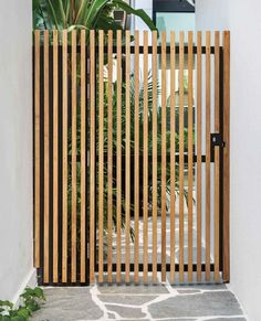 Outdoor Vertical Fences Wall Landscape Lighting Pavers Patio Porch Deck Shrubs and Side Yard Rosewood garden gate Unsealed the rosewood with grey naturally over time Photo 13 of 24 in Cloud House # Georges Braque, Landscape Lighting, Outdoor Lighting, Outdoor Pavers, Pavers Patio, Patio Fence, Front Fence, Pool Fence, Garden Floor