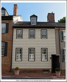 A circa 1798 Federal style wide clapboard sided house with a shared passageway entrance in the Annapolis Maryland Historic District. Photograph published on July 17th 2017. To view an enlarged version of the associated Annapolis Experience Blog post photograph, along with the post itself, click on the Visit button. Image and article Copyright 2017 G J Gibson Photography LLC and G Gibson Photo Art.