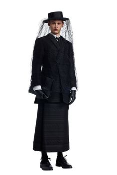 Following a gloomy but brilliant debut earlier this year during Paris Fashion Week, designer Thom Browne presents another look at his fall-winter 2015 menswear collection. Timely with new arrivals beginning in stores, Browne showcases his sartorial take on the funeral procession. Among the somber lineup are smart pieces, ranging from cropped pleated trousers and fitted...[ReadMore]