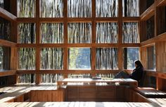 Liyuang Library Beijing China ... The architect used ordinary sticks to form a screen that conceals the library's glass facade. And talk about reclaimed materials: the sticks were found scattered around the village.