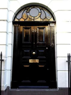 Striking Black Front Door and Transom