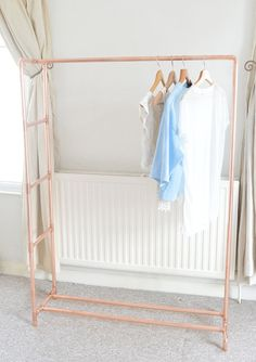This copper (rose gold colour) clothing rail will complement your home, shop, or studio. Baskets, boxes, shoes and other items can be placed along the bottom bars for extra storage or the bottom can be left open to highlight the airy, open, construction. Use the ladder to store scarves, blankets, towels, accessories or even necklaces. Alternatively leave the ladder open with just a few hanging plants on for a beautiful display. Each garment rack is made to order from industrial copper…